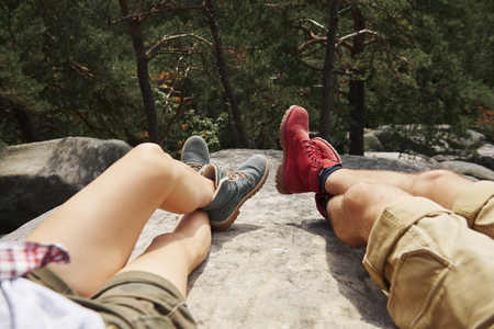 Shot of backpackers legs in the mountains Stock Photo