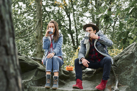 Backpackers drinking coffee or tea during hiking Stock Photo