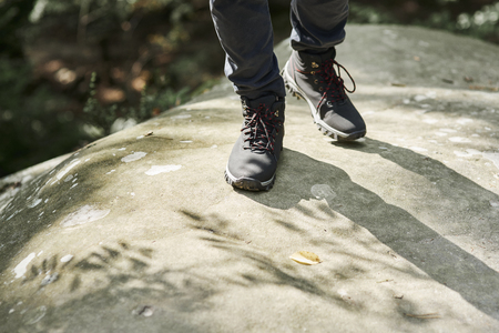 Close up of hikers legs Stock Photo