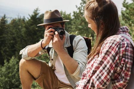 Tourist taking a photos during hiking trip
