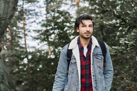 Portrait of adventurous hiker in forest
