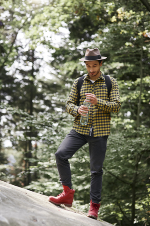 Male hiker drinking water in the mountains Stock Photo