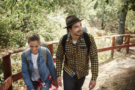 Young couple with backpacks hiking