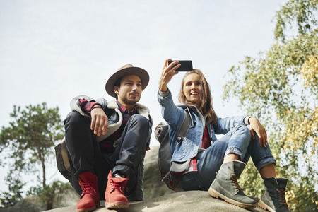 Happy couple making a selfie during hiking trip Stock Photo