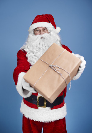 Man in santa claus costume giving christmas presents Stock Photo