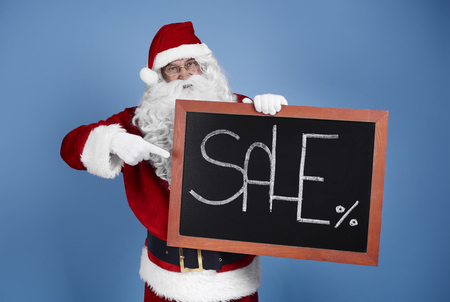 Man in santa claus costume with christmas banner Stock Photo