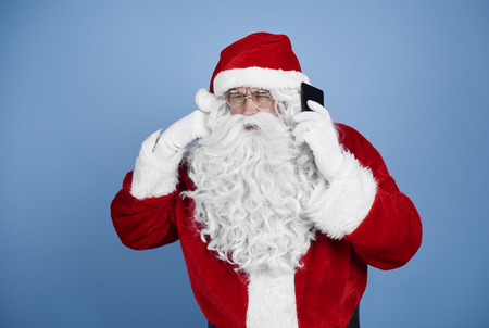 Santa claus talking by mobile phone