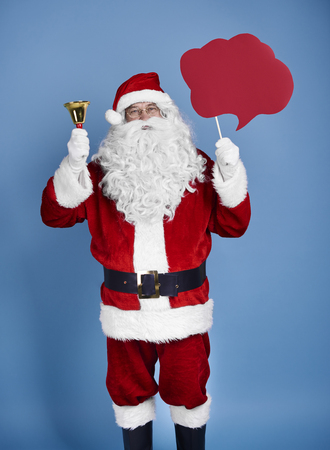 Santa claus holding speech bubble and bell