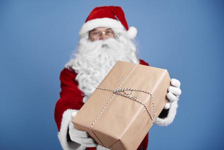 Defocused santa claus giving christmas presents