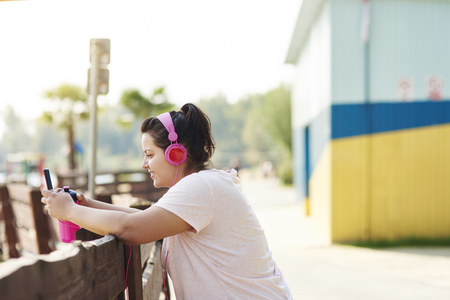 Woman choosing the best song for running