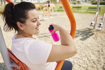 Young, happy woman exercising outdoors Stock Photo