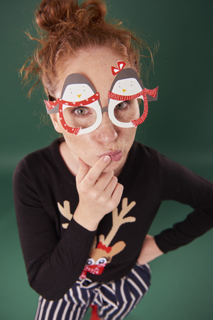 Young woman with funny christmas masks