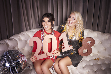 Women with new years number at night club Stock Photo