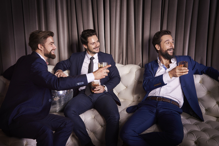 Male friends at the party Stock Photo