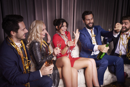 Cheerful friends celebrating a new year at night club Stock Photo