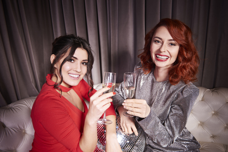 Elegant women making a toast to  new year