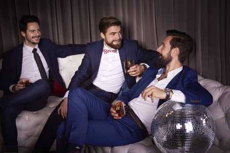 Male friends celebrating new years eve Stock Photo