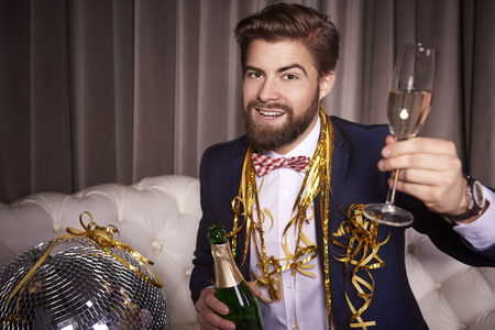 Portrait of cheerful businessman with champagne toasting Stock Photo