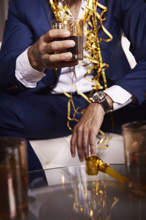 Unrecognizable businessman with whiskey at night club Stock Photo