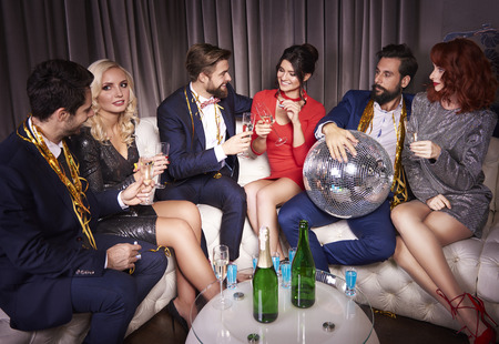 Group of people with champagne enjoying at party