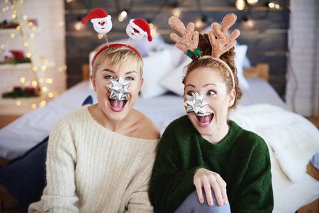 Portrait of playful friends at Christmas Imagens