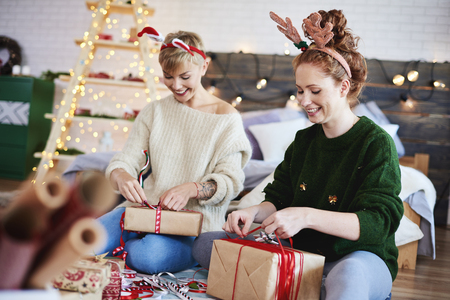 Happy girls making christmas presents Stock Photo