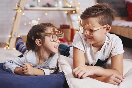 Portrait of playful siblings in bedroom 스톡 콘텐츠