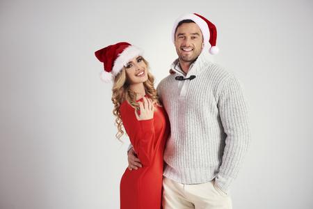 Portrait of loving couple with santa hat at studio shot Stock Photo