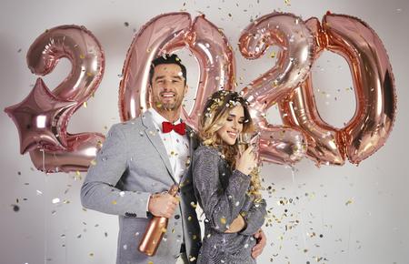 Loving couple celebrating New Year 스톡 콘텐츠