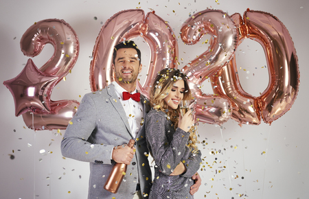 Loving couple celebrating New Year Stock Photo