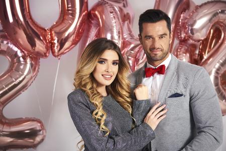 Portrait of loving couple celebrating New Year