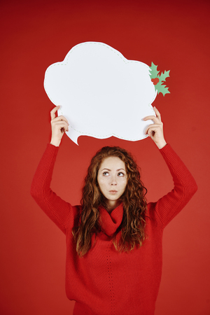 Girl with speech bubble looking up Stock Photo