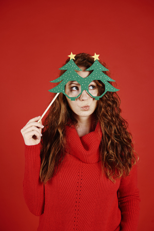 Girl with christmas mask looking at copy space