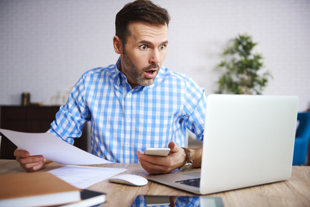 Shocked and worried businessman at work