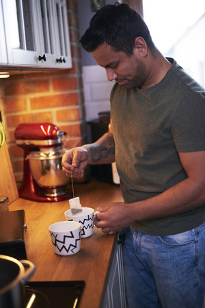 Man making tea in the kitchen
