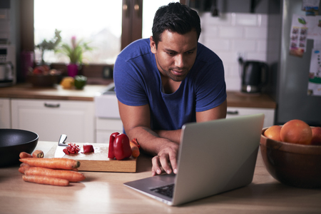 Man looking for perfect recipe