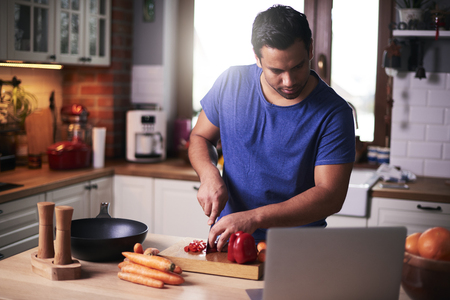 Man cutting vegetable in the kitchen