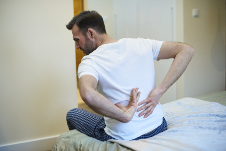 Rear view of man suffering from a backache Stock Photo