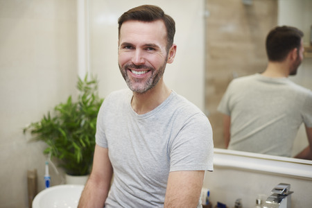 Portrait of smiling man in the bathroom