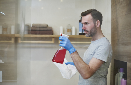 Side view of focused man cleaning