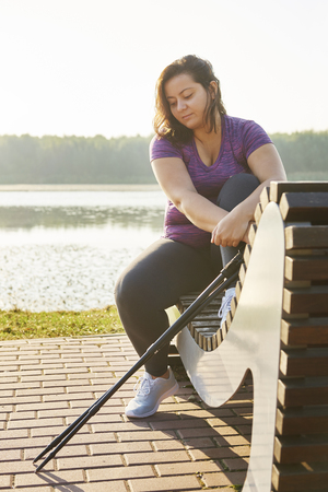 Woman with hiking poles taking a short break Stock Photo