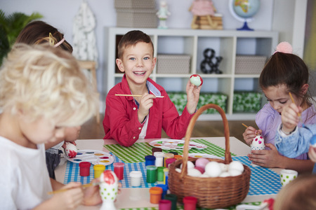 Group of children painting easter eggs  Stock Photo