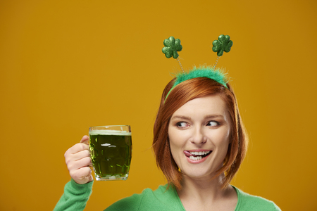 Playful leprechaun with green beer Stock Photo