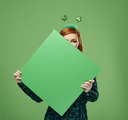 Woman's hands holding banner with copy space in studio shot Banco de Imagens - 118383492
