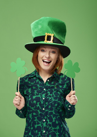 Portrait of smiling leprechaun with clover shaped banner