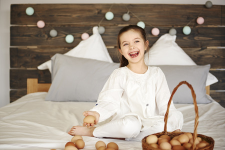 Happy child having fun with eggs