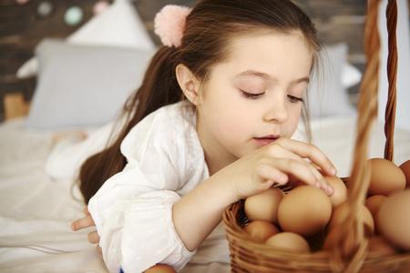 Focused girl watching the eggs