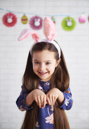Portrait of playful girl in rabbit costume