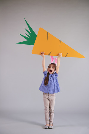 Strong child holding easter banner with copy space