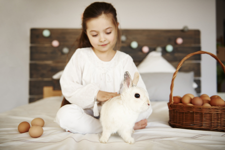 Affectionate child stroking the rabbit